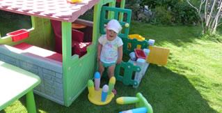 child plays in the garden